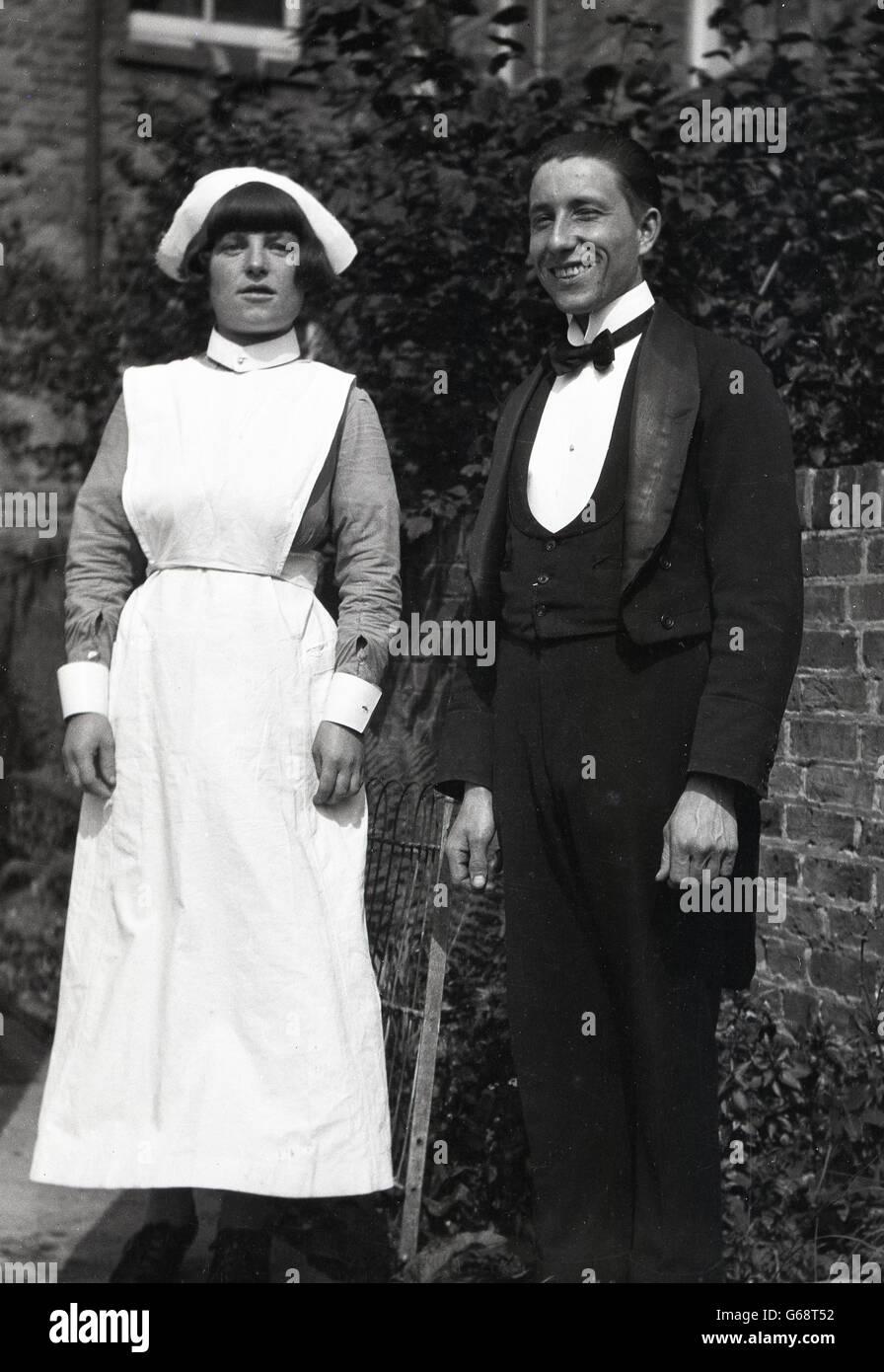1930s, historical, Butler of a household with female housekeeper outside, possibly a live-in couple. - Stock Image