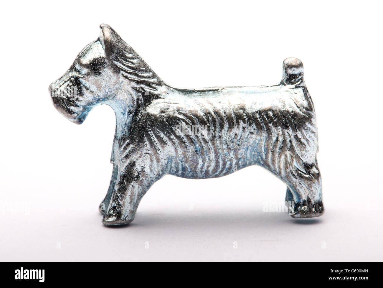 Monopoly Dog piece against a white background - Stock Image