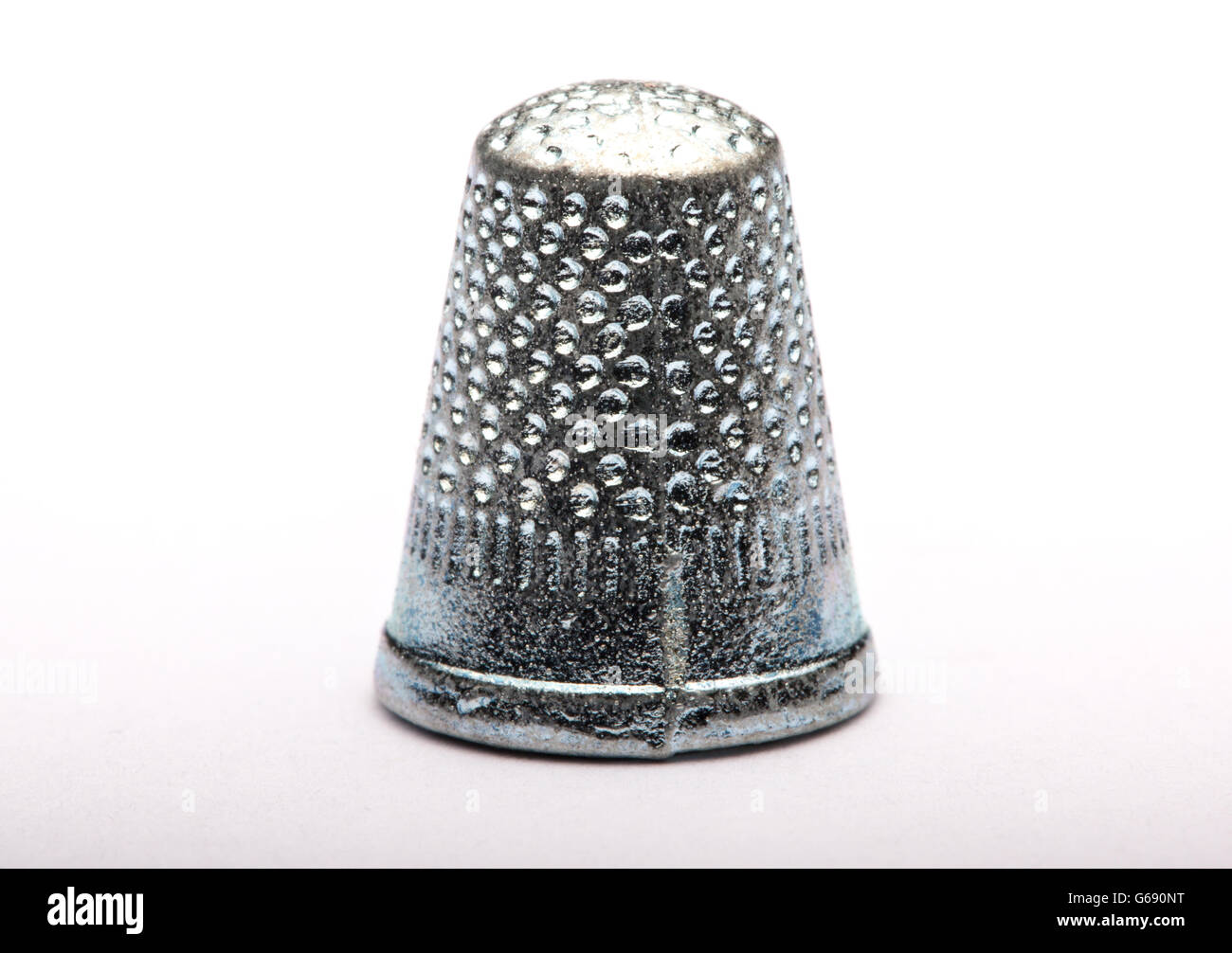 monopoly thimble piece against a white background - Stock Image