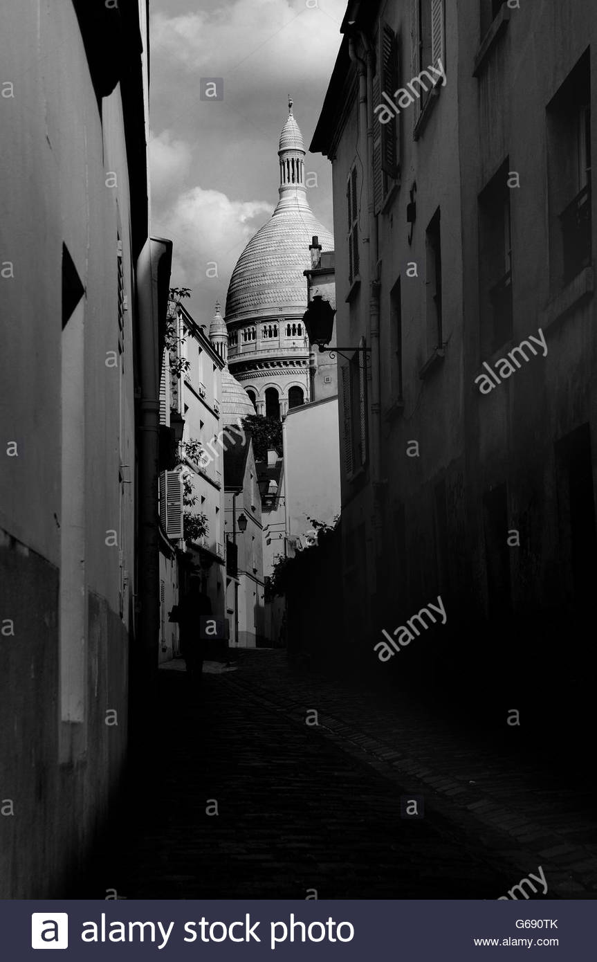 View of the Scare Coeur from an dark alleyway in Paris, France - Stock Image