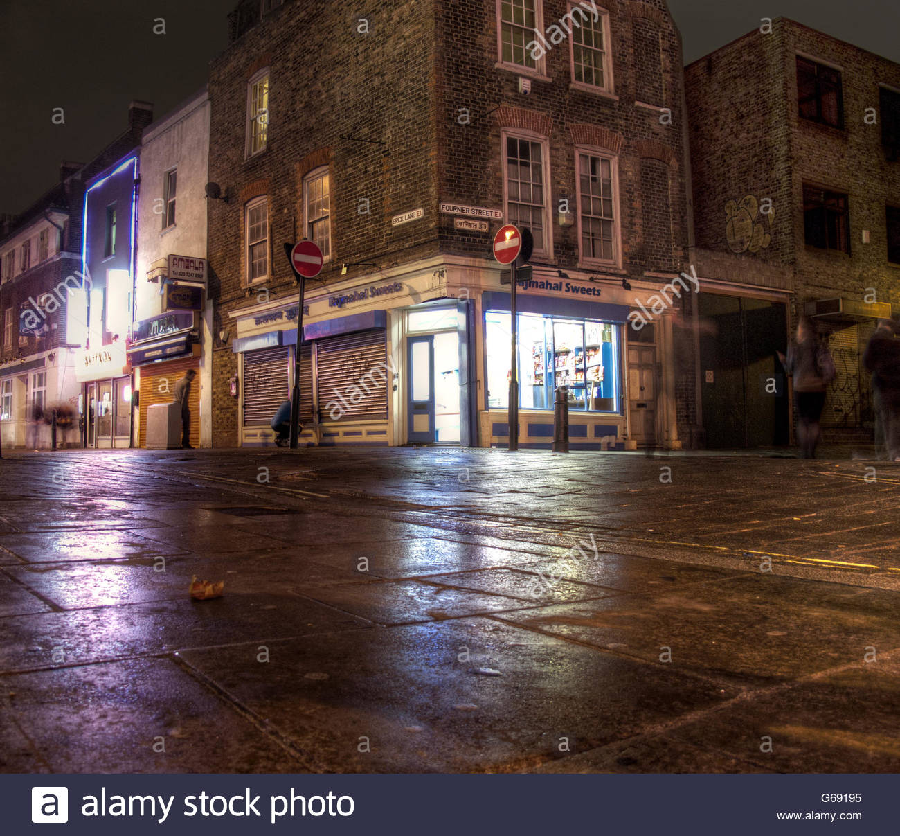 Brick Lane corner shop at night - Stock Image