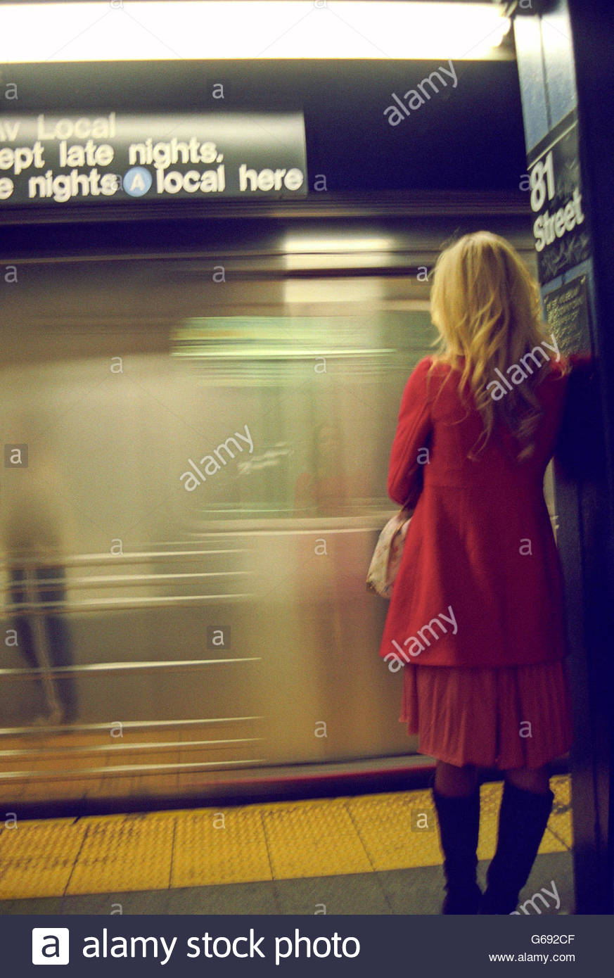 Woman Standing in Subway - Stock Image