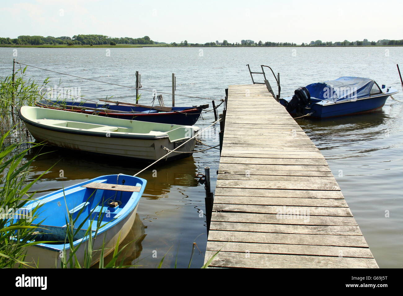 Boats in the bay of Nature reserve Neuendorfer Wiek on the island Rugen. Germany - Stock Image