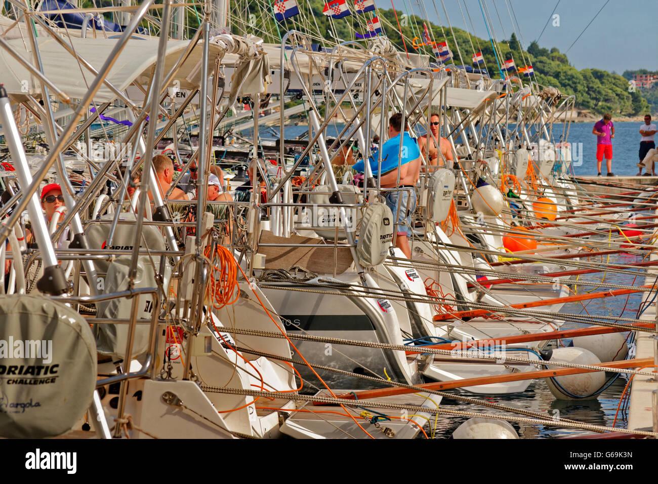 Croatian charter cruising yachts on marina pontoon on Adriatic coast of Croatia. - Stock Image