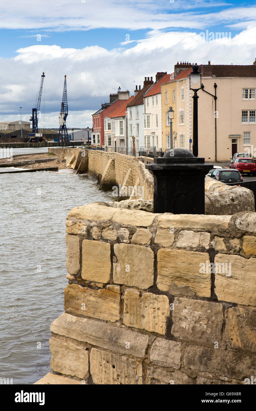 UK, County Durham, Hartlepool Headland, Town Wall, colourful houses opposite dockside cranes - Stock Image
