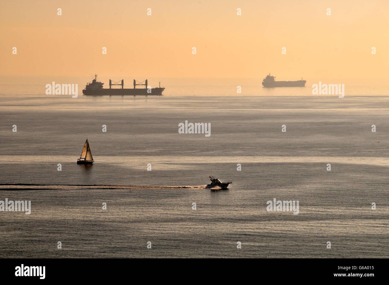 Four boats front the city of Tarragona (Catalonia), Spain. - Stock Image