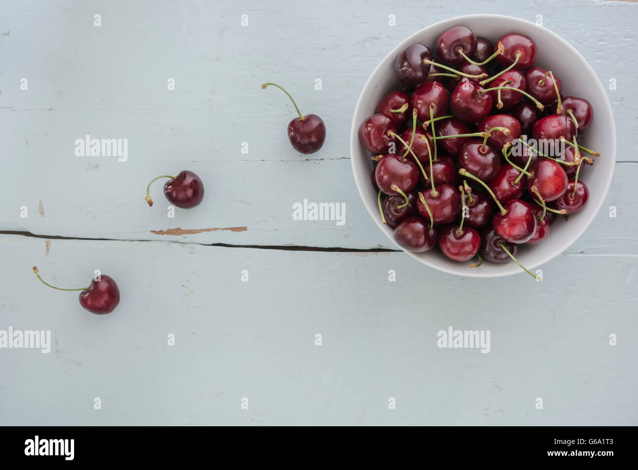 Cherries in white bowl. - Stock Image