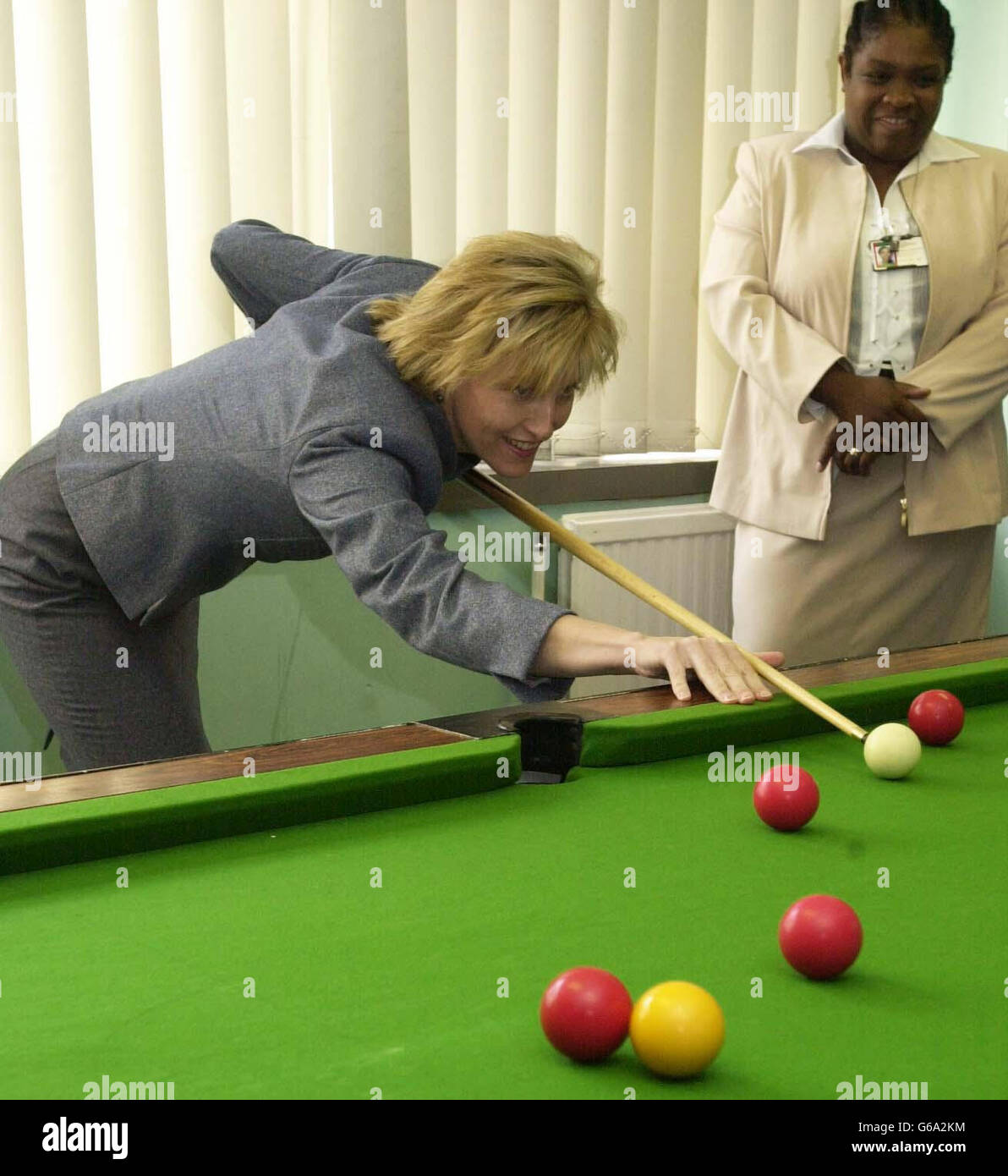 The Countess of Wessex tries her hand at pool watched by Mrs Maureen Earle, a bail support and remand officer, during Stock Photo