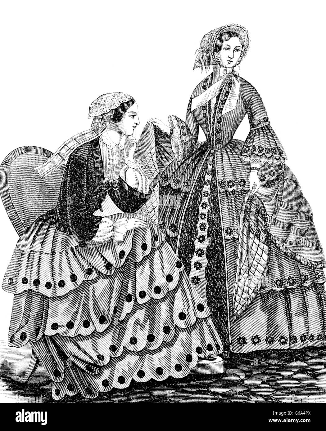 1850s ENGRAVING OF WOMEN'S FASHIONS FROM HARPER'S MAGAZINE CIRCA 1853 - Stock Image