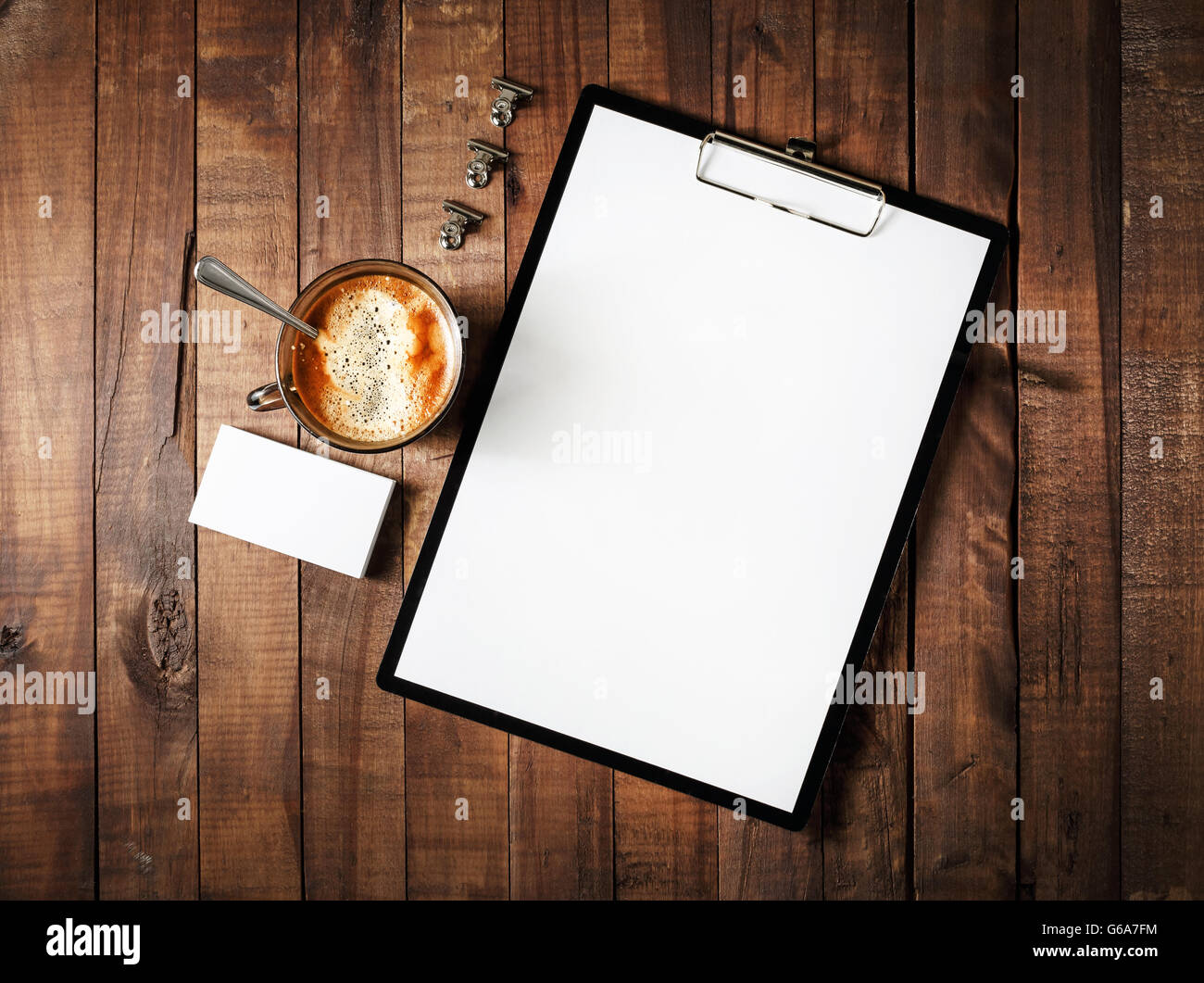 photo of blank stationery on vintage wooden table background blank