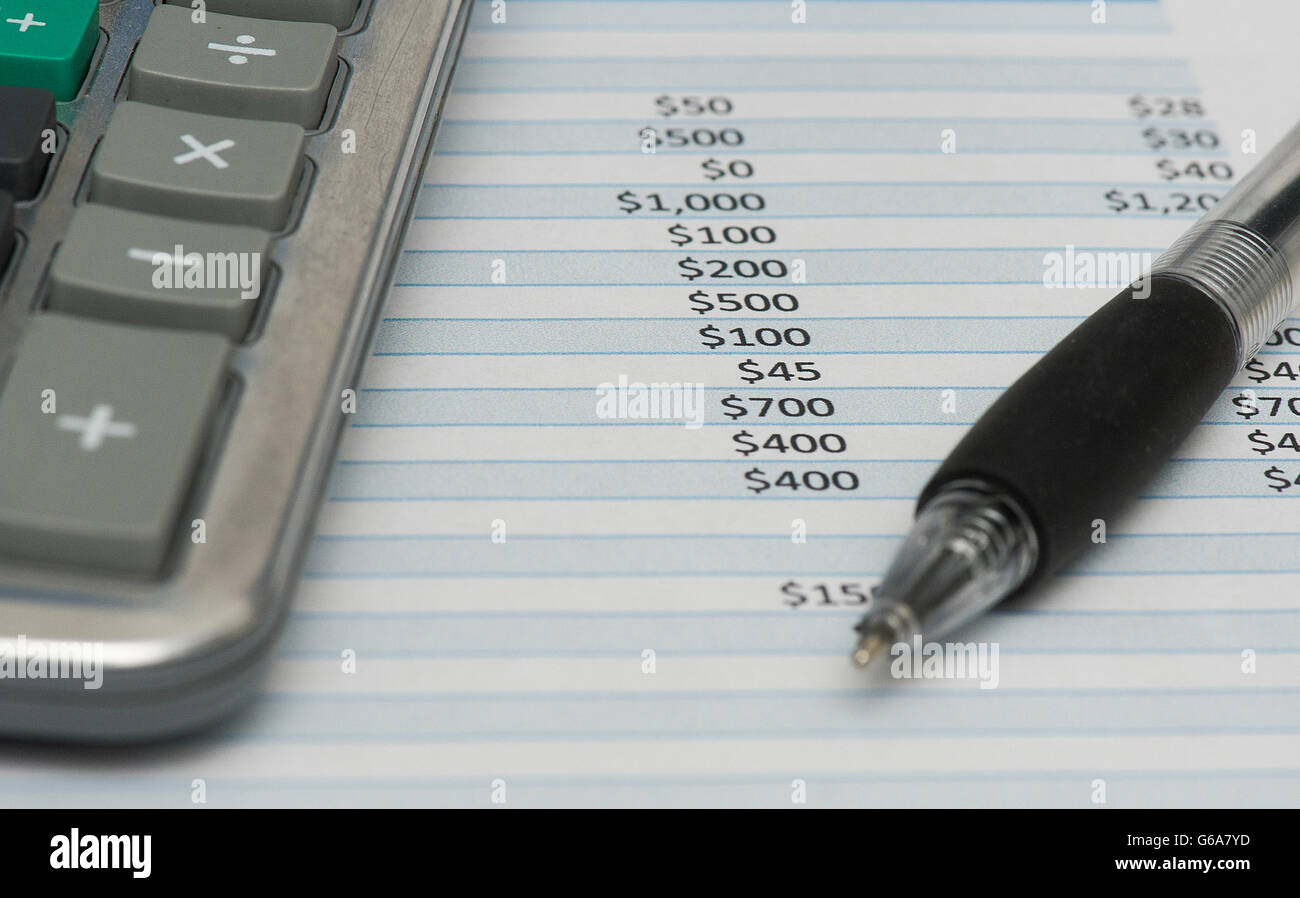 A calculator, pen and expense sheet are shown in Montreal, Thursday, June 23, 2016. photo Graham Hughes/Freelance - Stock Image