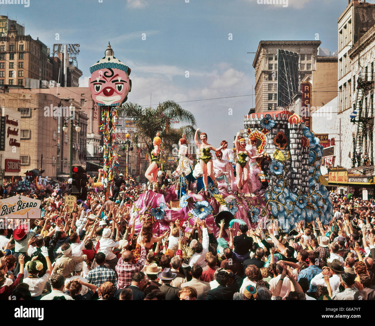 1960s MARDI GRAS REX PARADE ON CANAL STREET FEBRUARY 14 1961 CROWD REACHING FOR TRINKETS NEW ORLEANS LA USA - Stock Image