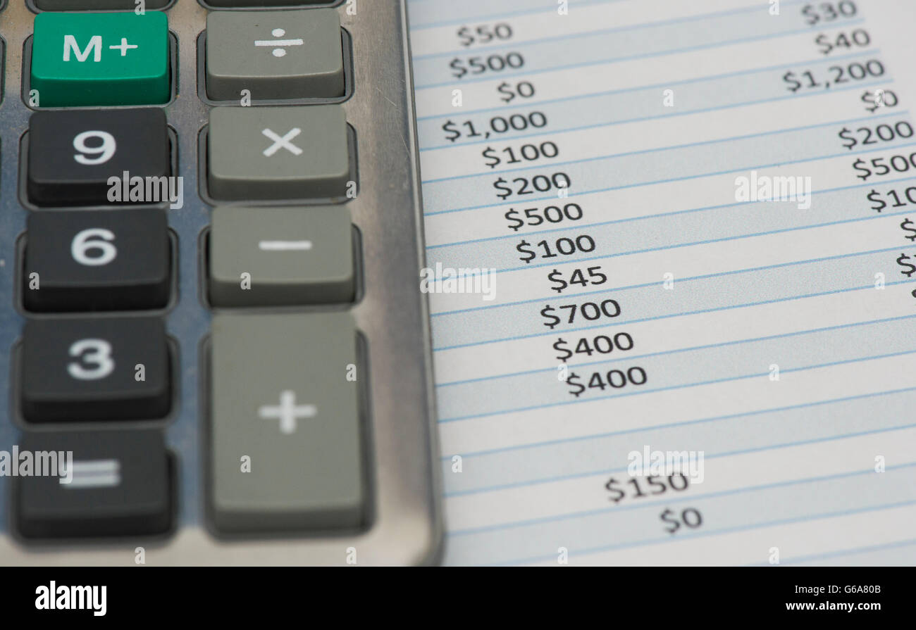 A calculator and expense sheet are shown in Montreal, Thursday, June 23, 2016. photo Graham Hughes/Freelance - Stock Image