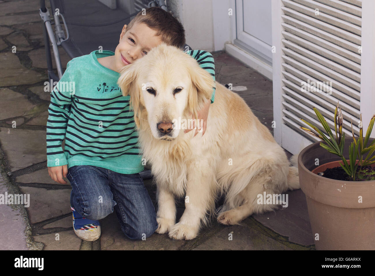 Boy with family dog - Stock Image