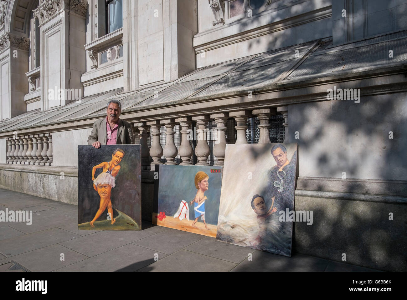 Whitehall, London, UK. 24th June 2016. Artist with political canvases plies his wares outside Downing Street in - Stock Image