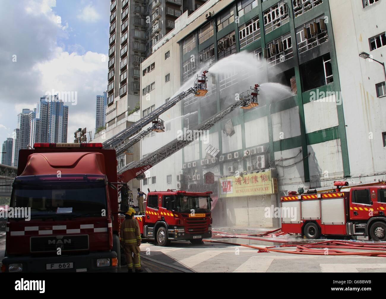 Hong Kong, China. 24th June, 2016. Firefighters put out fire at a multi-storey industrial building in East Kowloon - Stock Image