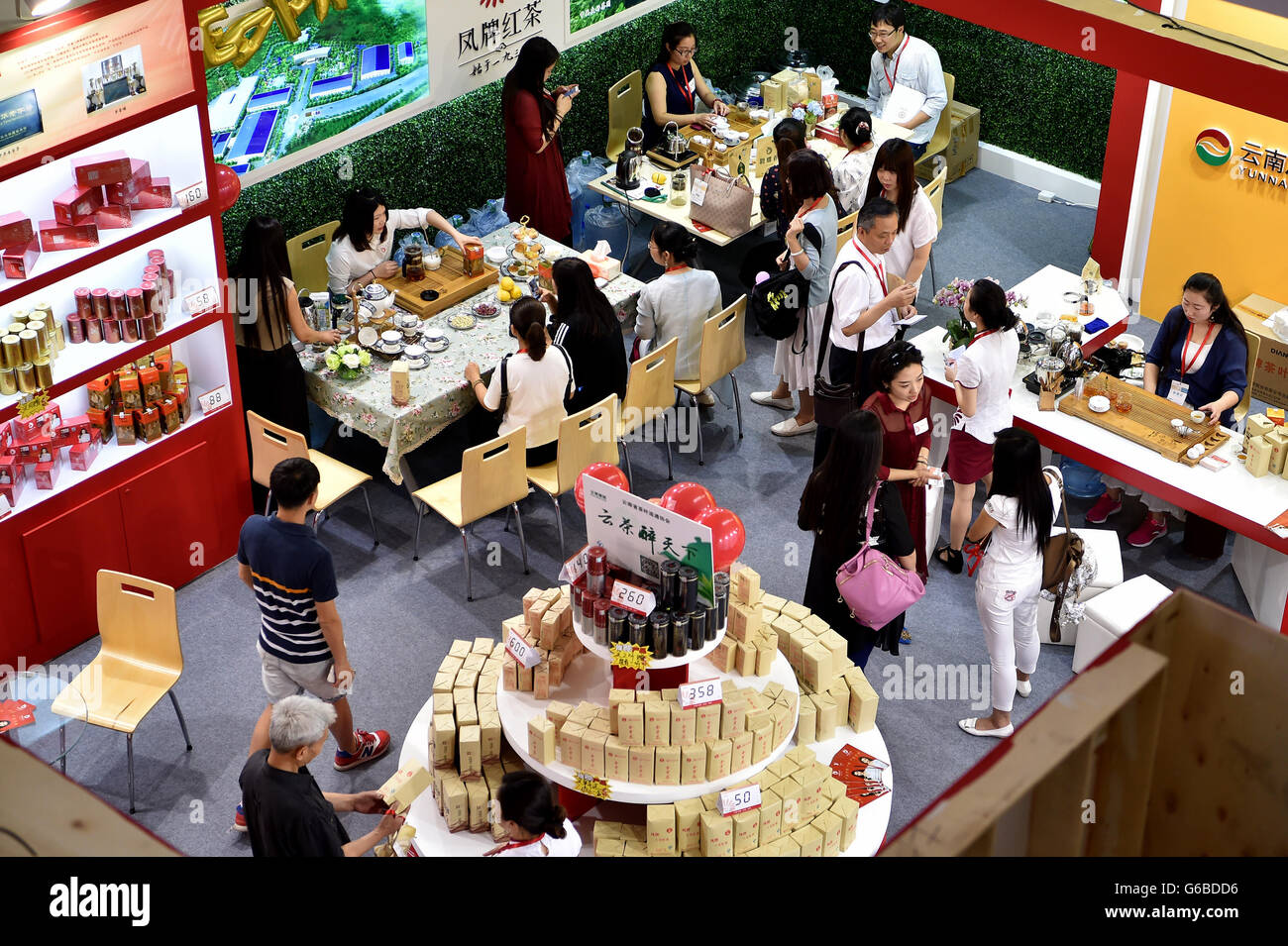 Beijing, China. 24th June, 2016. Visitors tast tea during the Beijing International Tea Expo in Beijing, capital - Stock Image