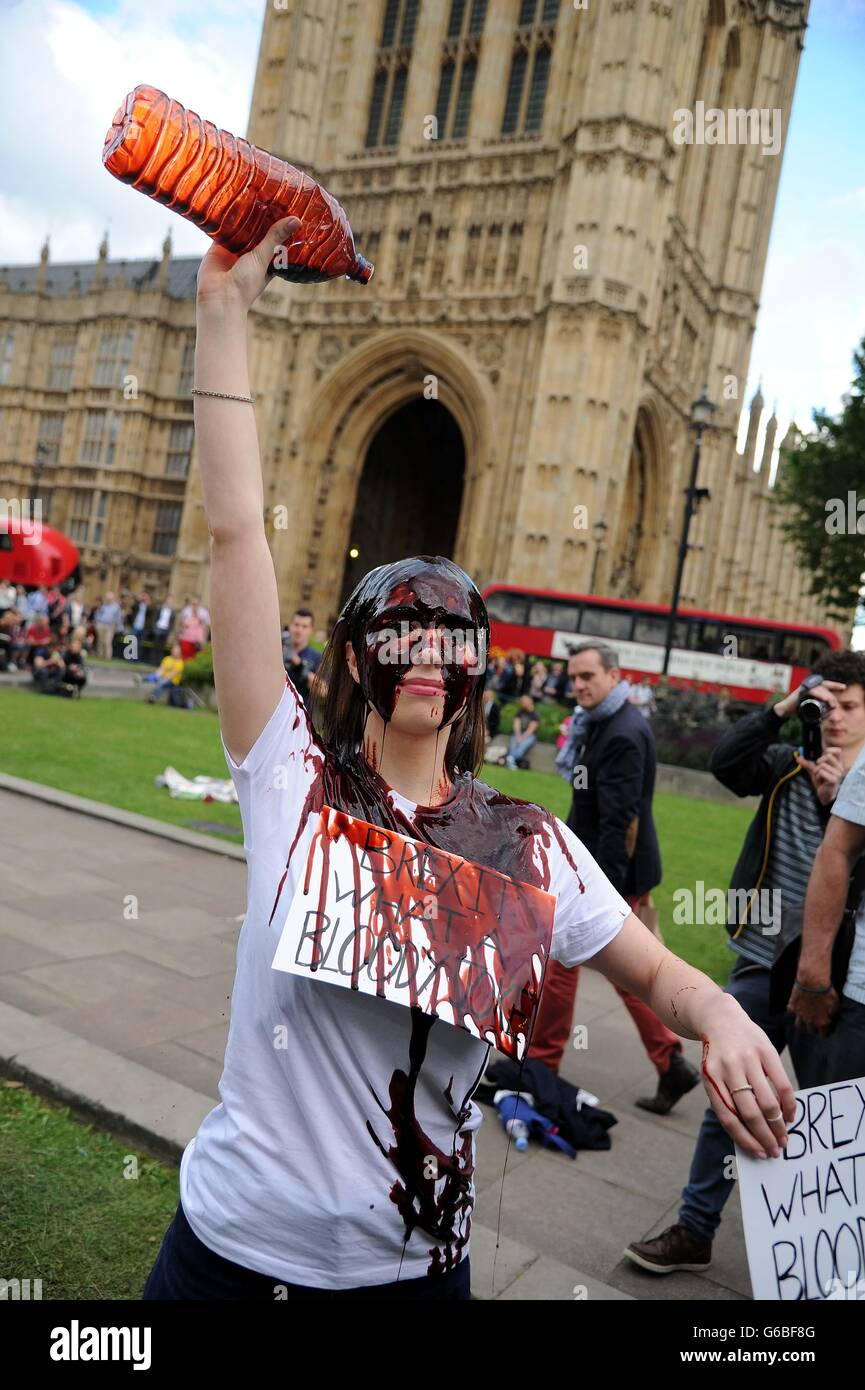 Brexit protester pours fake blood over herself on the day of the EU Referendum result, London, UK - Stock Image