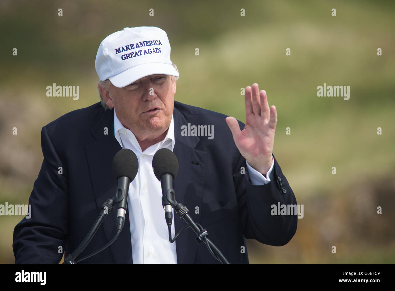Republic presidential nominee Donald Trump holds a press conference on the 9th hole tee, with his family members - Stock Image