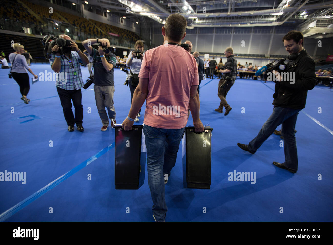 Glasgow, UK. 23rd June, 2016. The ballot boxes containing the votes arrive in the Emirates Arena to begin the count - Stock Image