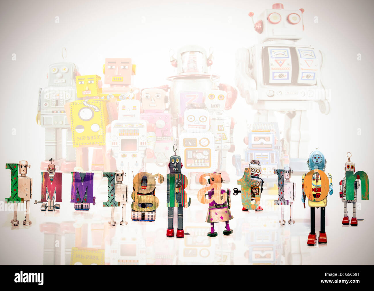 The Word  immigration with retro robot toys - Stock Image
