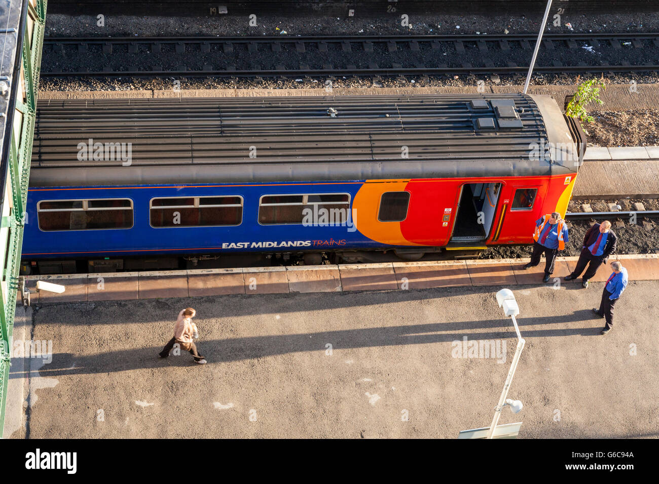 View from above of railway staff, passenger and train waiting at a platform, Nottingham Railway Station, Nottingham, - Stock Image