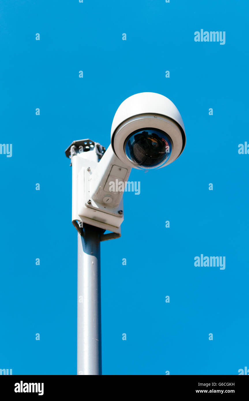 Dome surveillance camera on a pole. - Stock Image