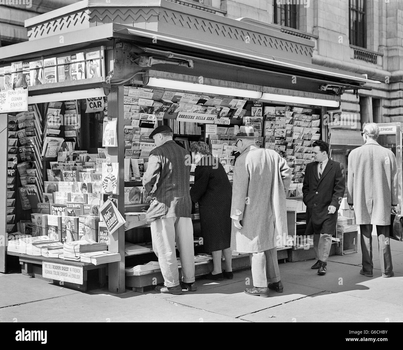 1960s PEOPLE AT NEWSSTAND 42ND STREET NEW YORK CITY NY USA - Stock Image