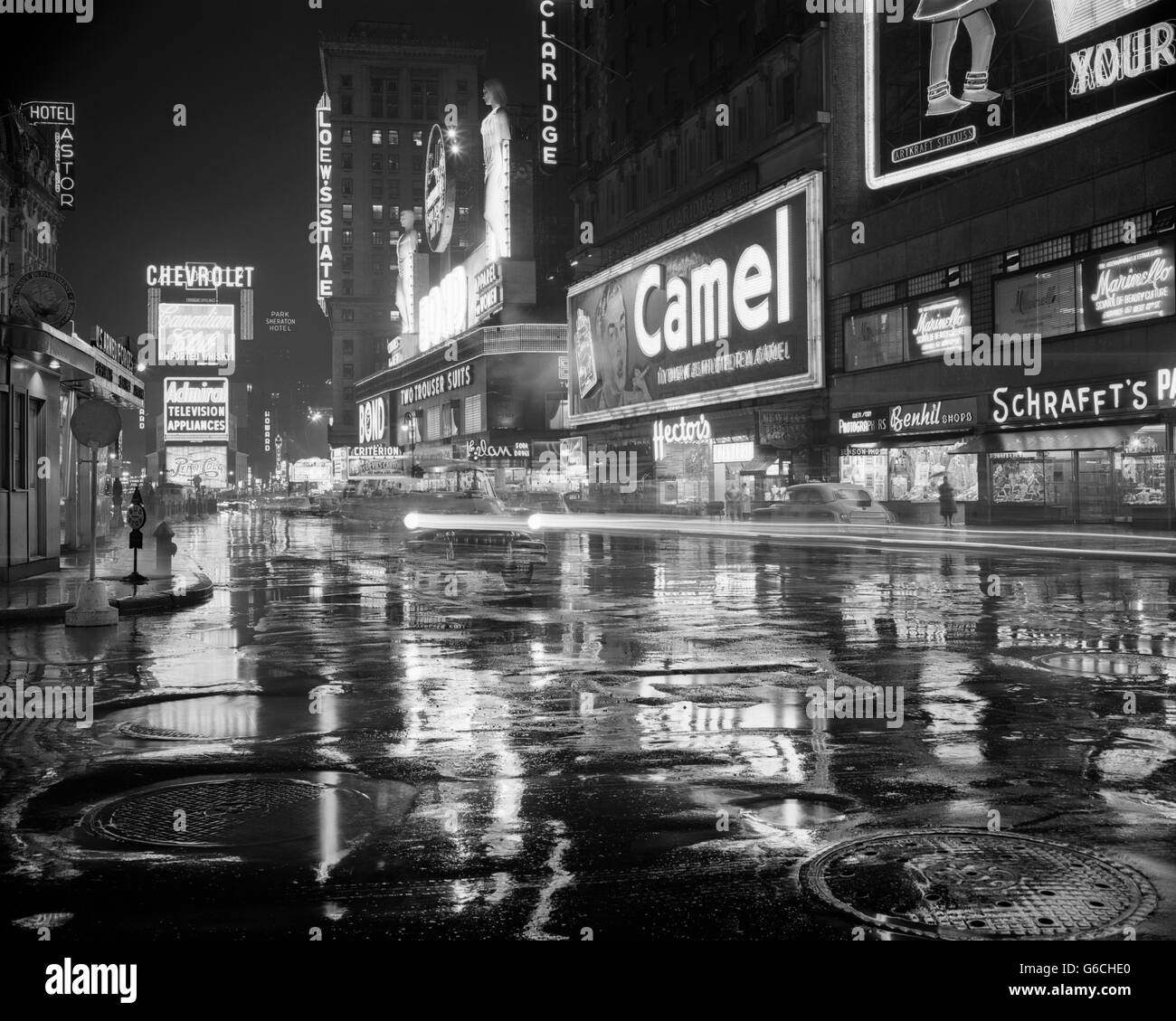 1950s WET RAINY STREETS OF TIMES SQUARE AT NIGHT NEON SIGNS ADVERTISING NEW YORK CITY NY