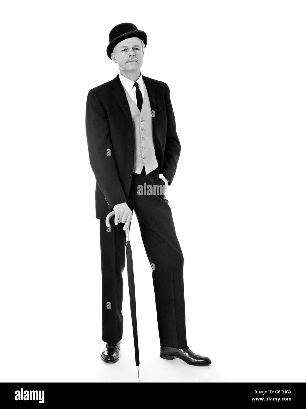 768254153c2 1960s PORTRAIT FULL LENGTH MAN WEARING THREE PIECE SUIT BOWLER HAT HOLDING  AN UMBRELLA VERY BRITISH ENGLISH LOOK