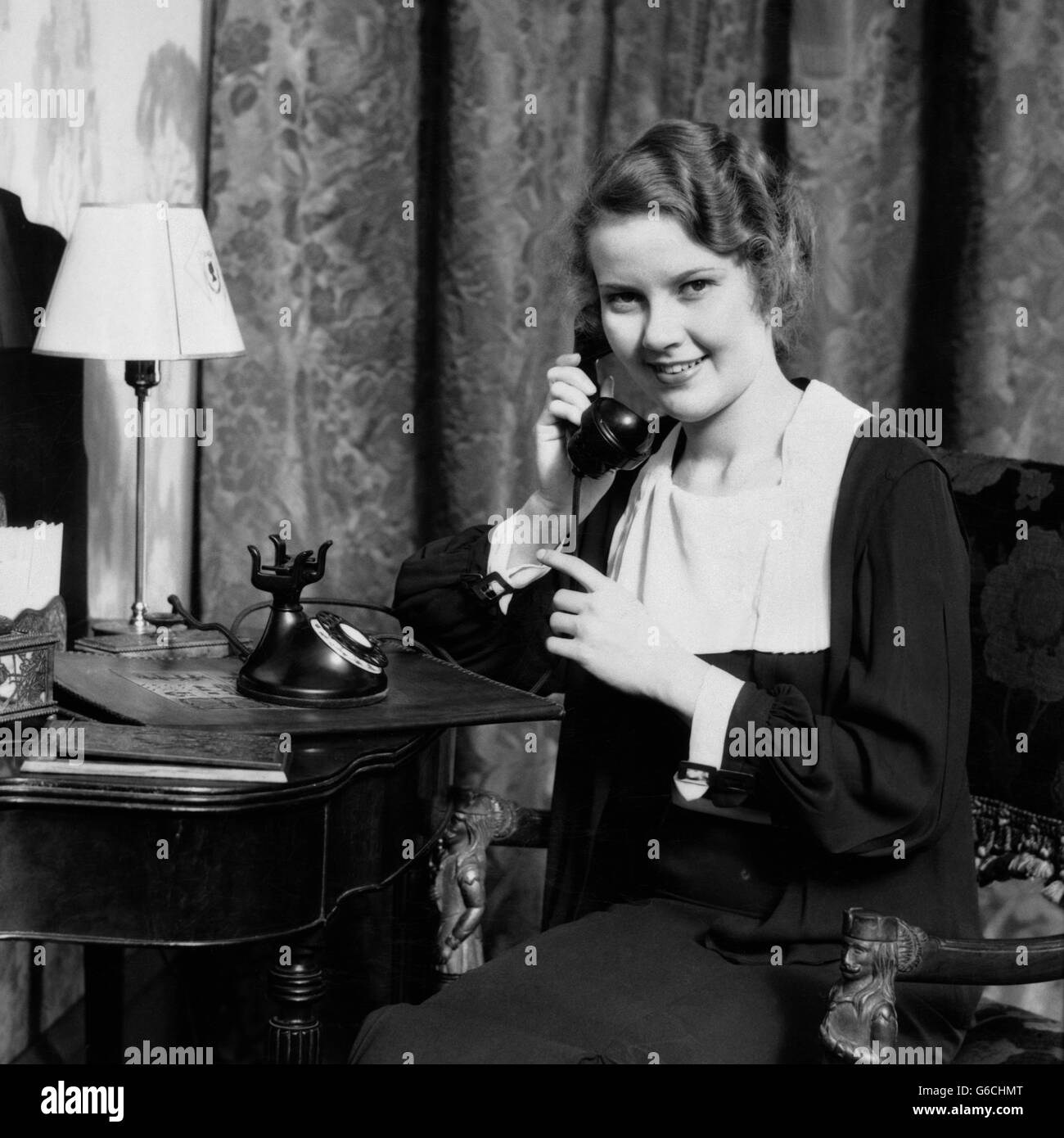 1930s Smiling Woman Sitting At Desk Vanity Table With Mirror Lamp Stock Photo 107227480 Alamy