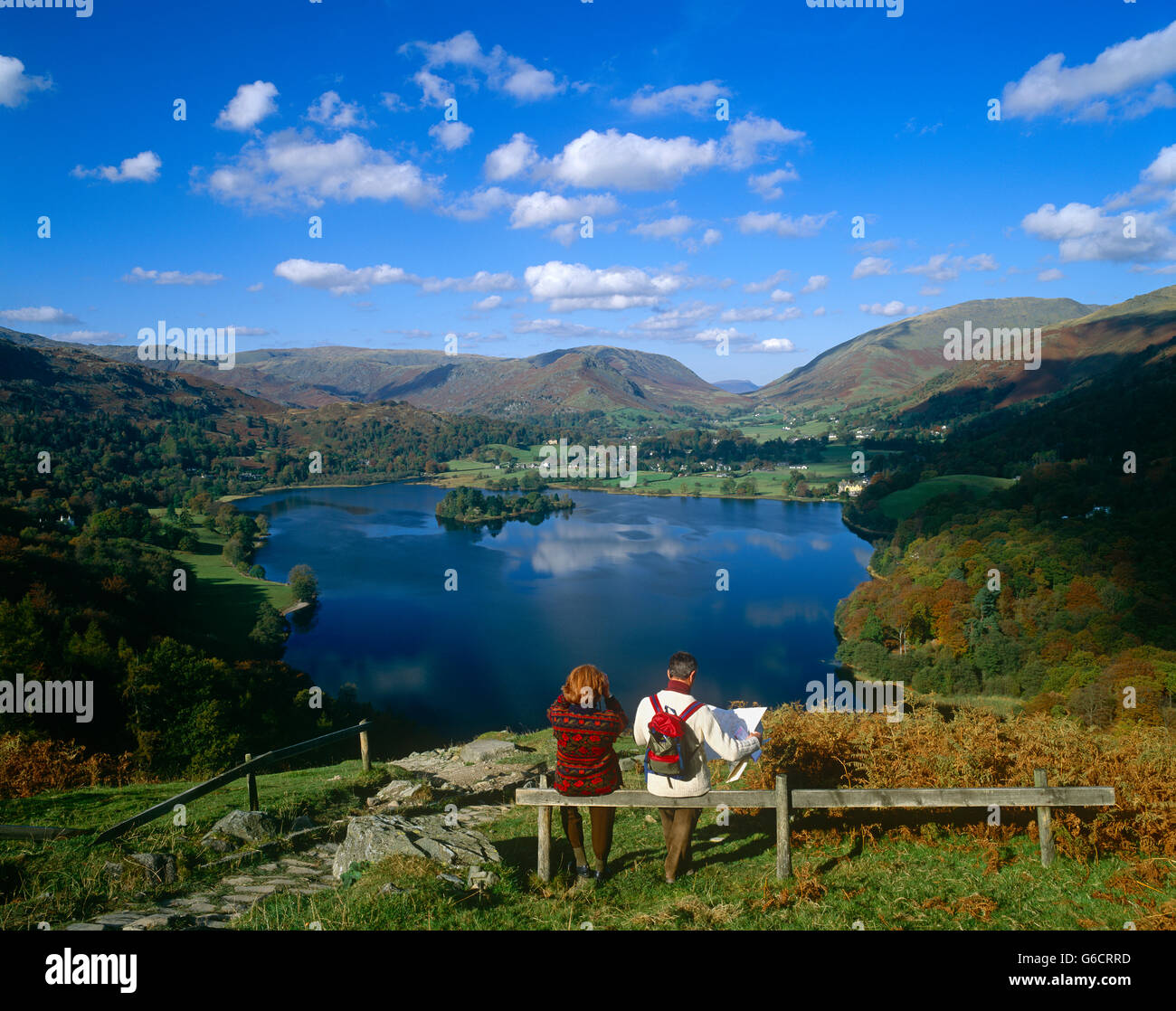 Ramblers viewing Grasmere in the Lake District, Cumbria, England, UK - Stock Image