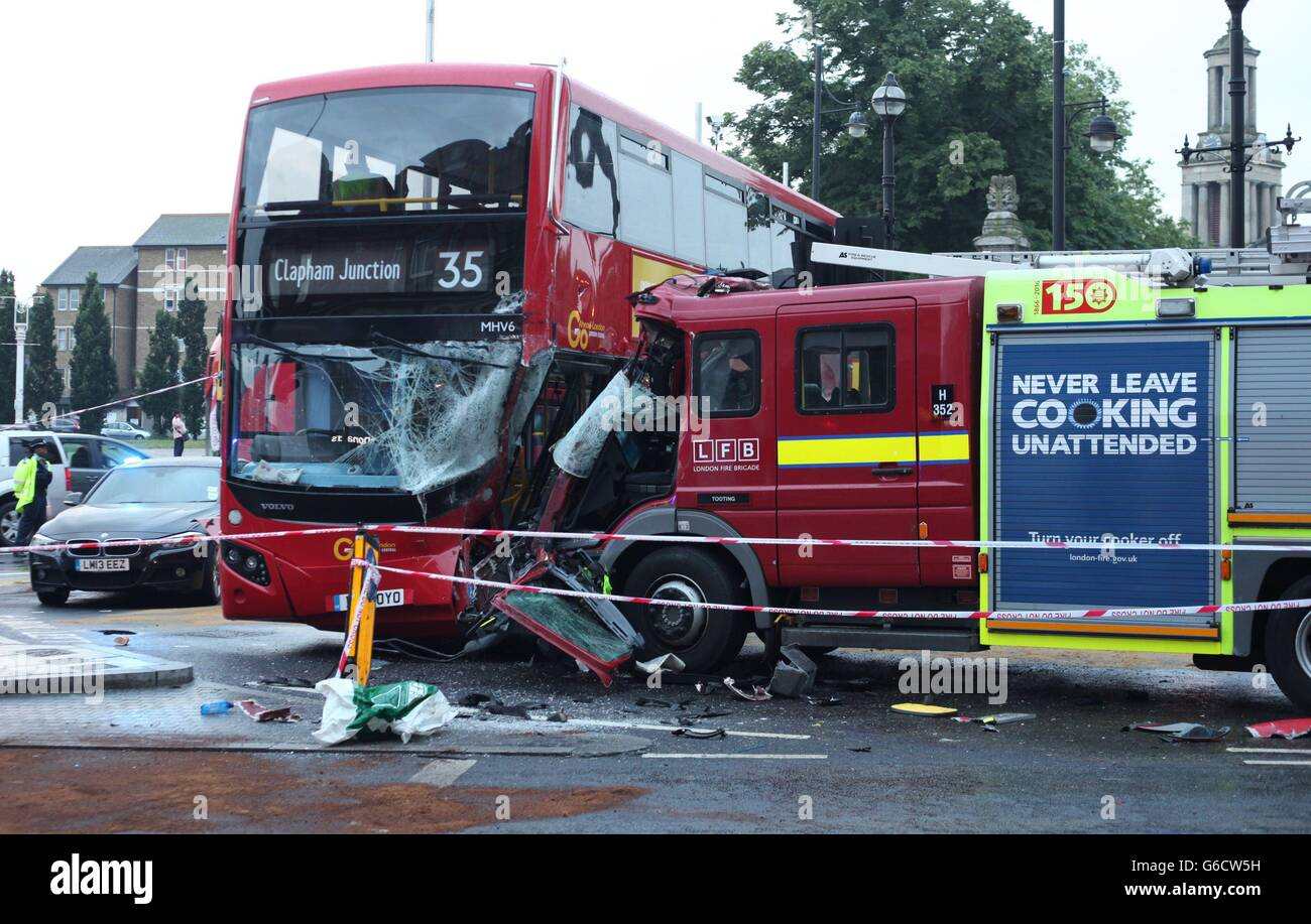 A view of the scene following a collision involving a bus, fire ...