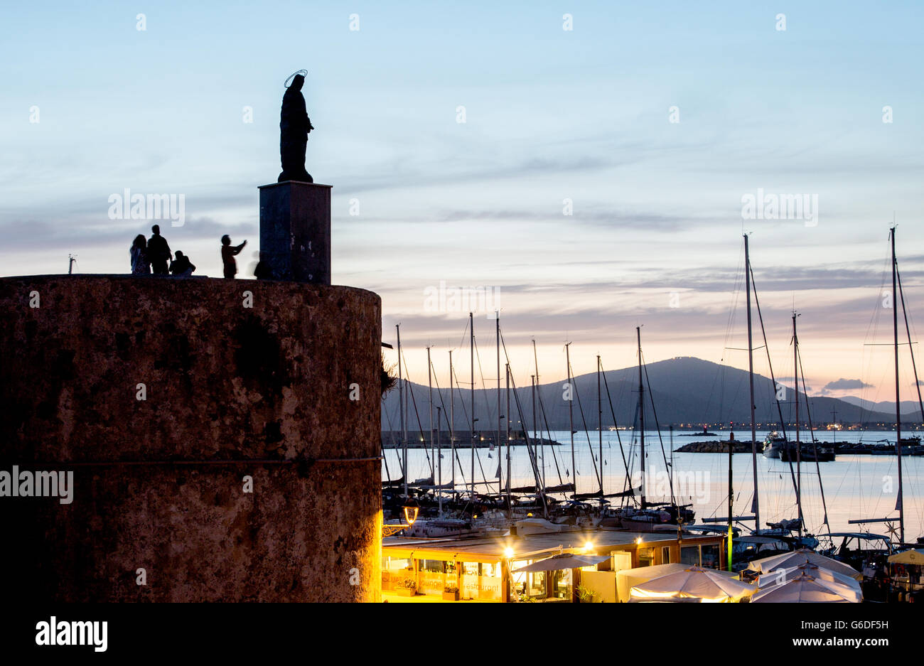 The Christ and Yachts In The Marina at Night Alghero Sardinia Italy - Stock Image
