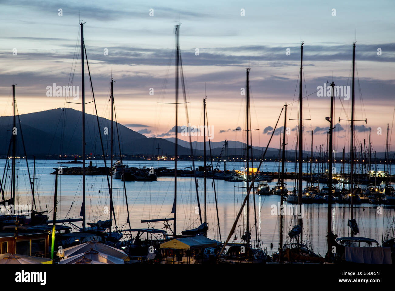 Yachts In The Marina at Night Alghero Sardinia Italy - Stock Image