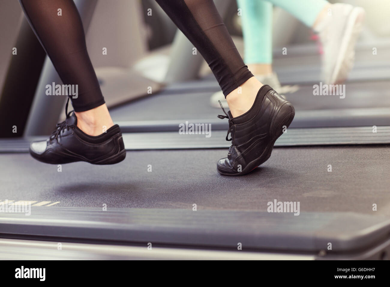 Close up of female legs on tredmill - Stock Image