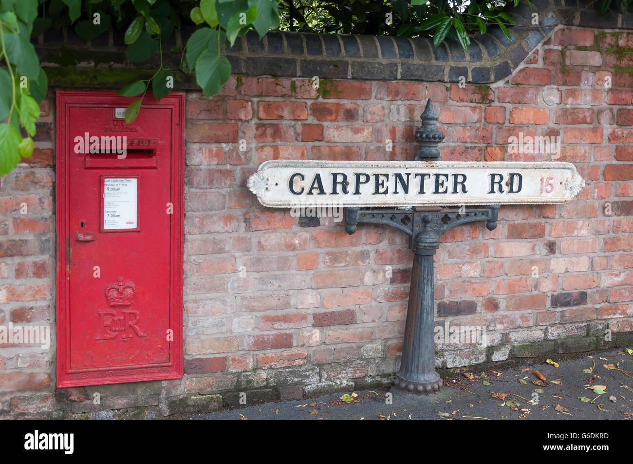 Period road sign and post box, Carpenter Road, Edgbaston, Birmingham, West Midlands, England, United Kingdom - Stock Image