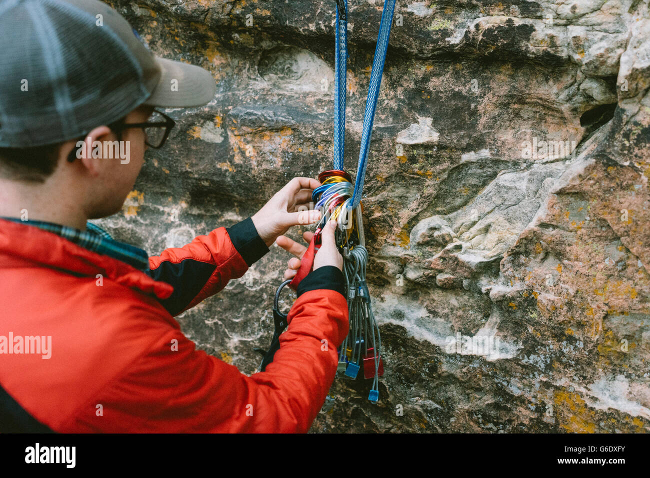 A climber organizing gear in Red Rock Canyon, Nevada - Stock Image