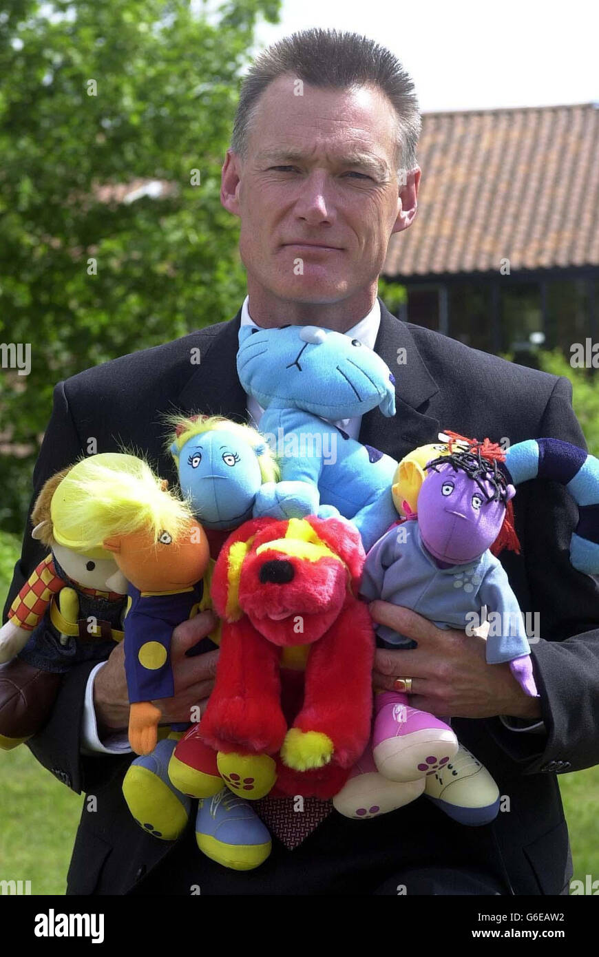 Steve Holland hold counterfeit toys - Stock Image