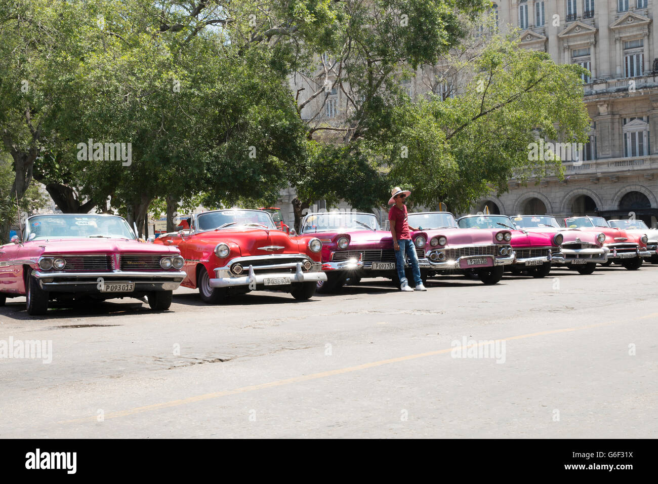 A row of classic convertibles for hire in Havana, Cuba - Stock Image