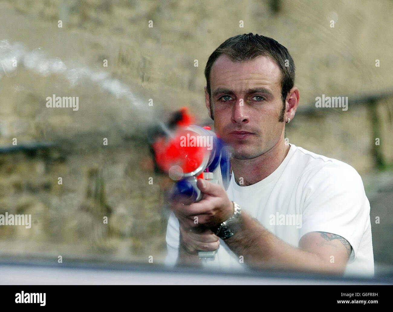 Waterpistol fight leads to CS Spray use - Stock Image