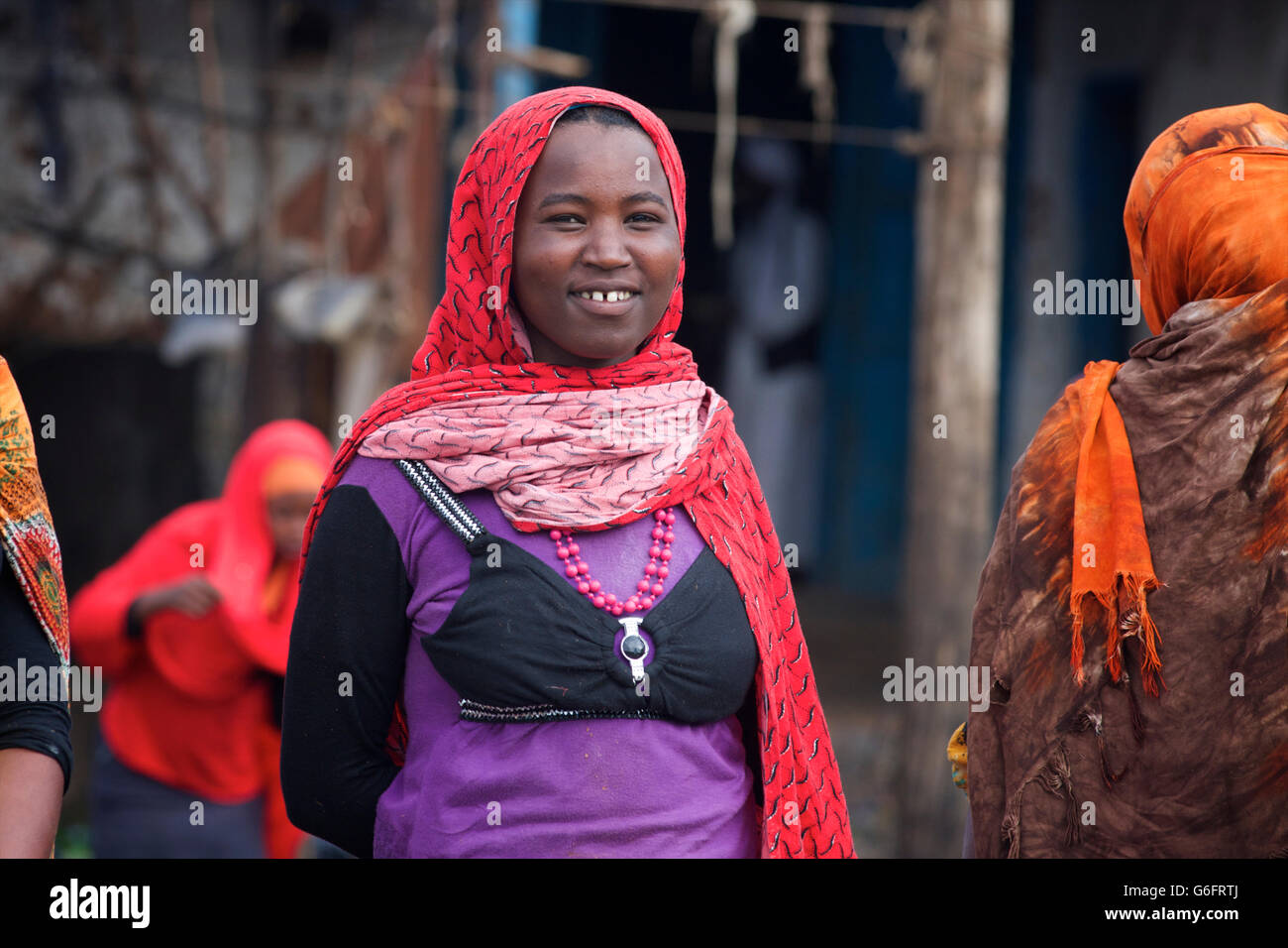 Oromo woman wearing a hijab and a bra-type garment over her top. Near Harar, Ethiopia - Stock Image
