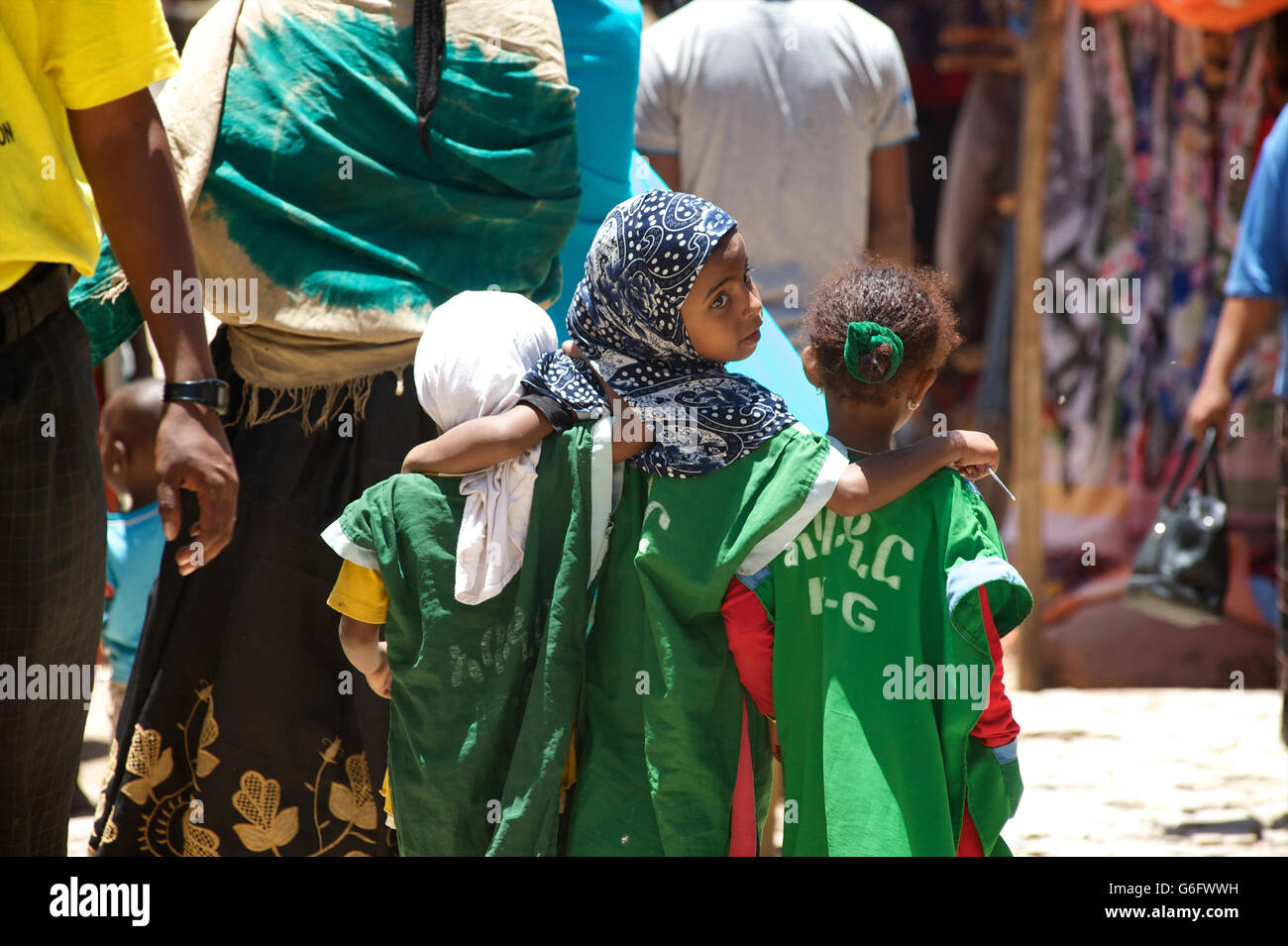 Ethiopian schoolchildren arm in arm  together in the street, Harar, Ethiopia - Stock Image
