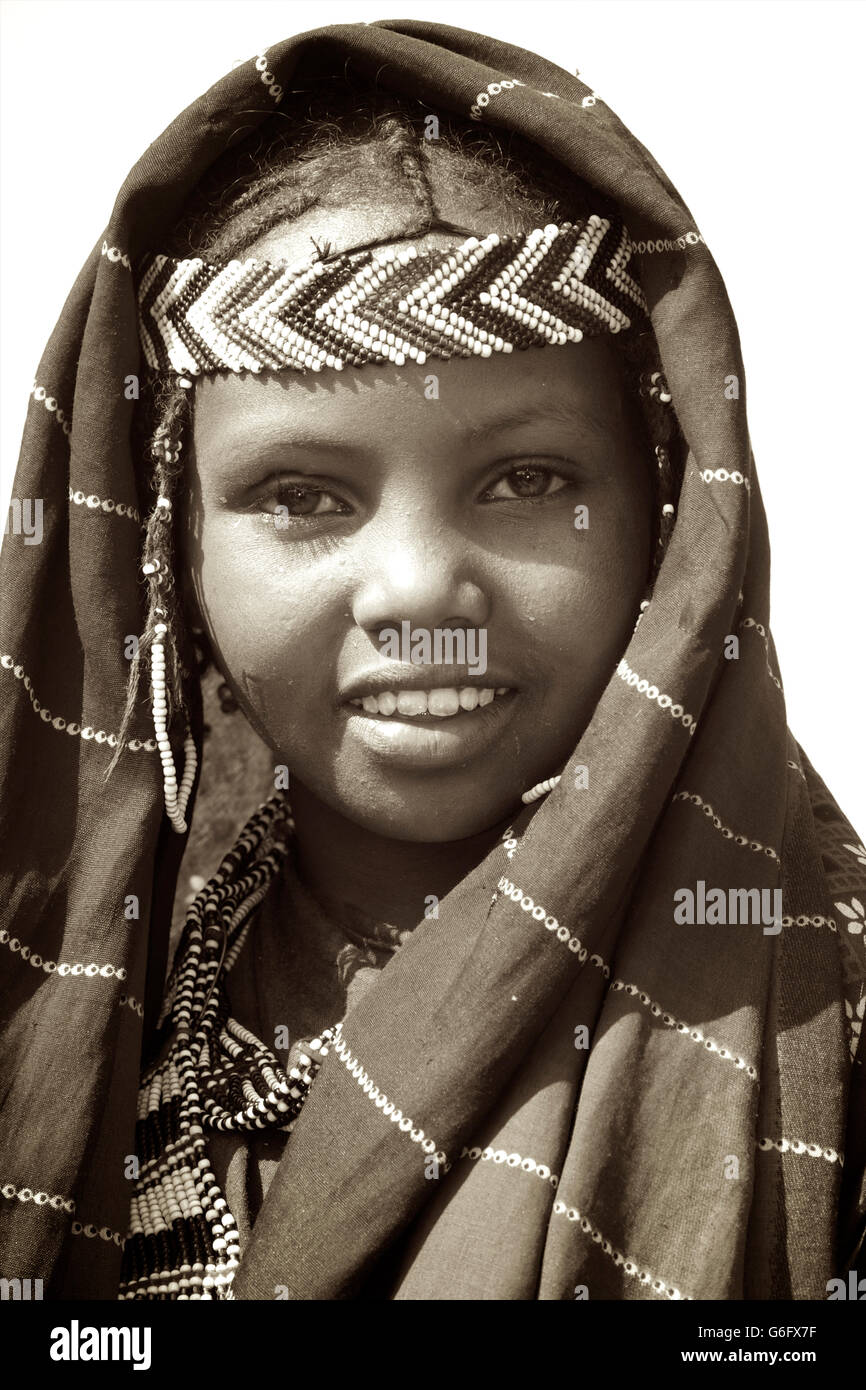 An Afar girl in tribal attire. The nomadic Afar  live in the low-lying deserts of Eastern Ethiopia. Welo Province, - Stock Image