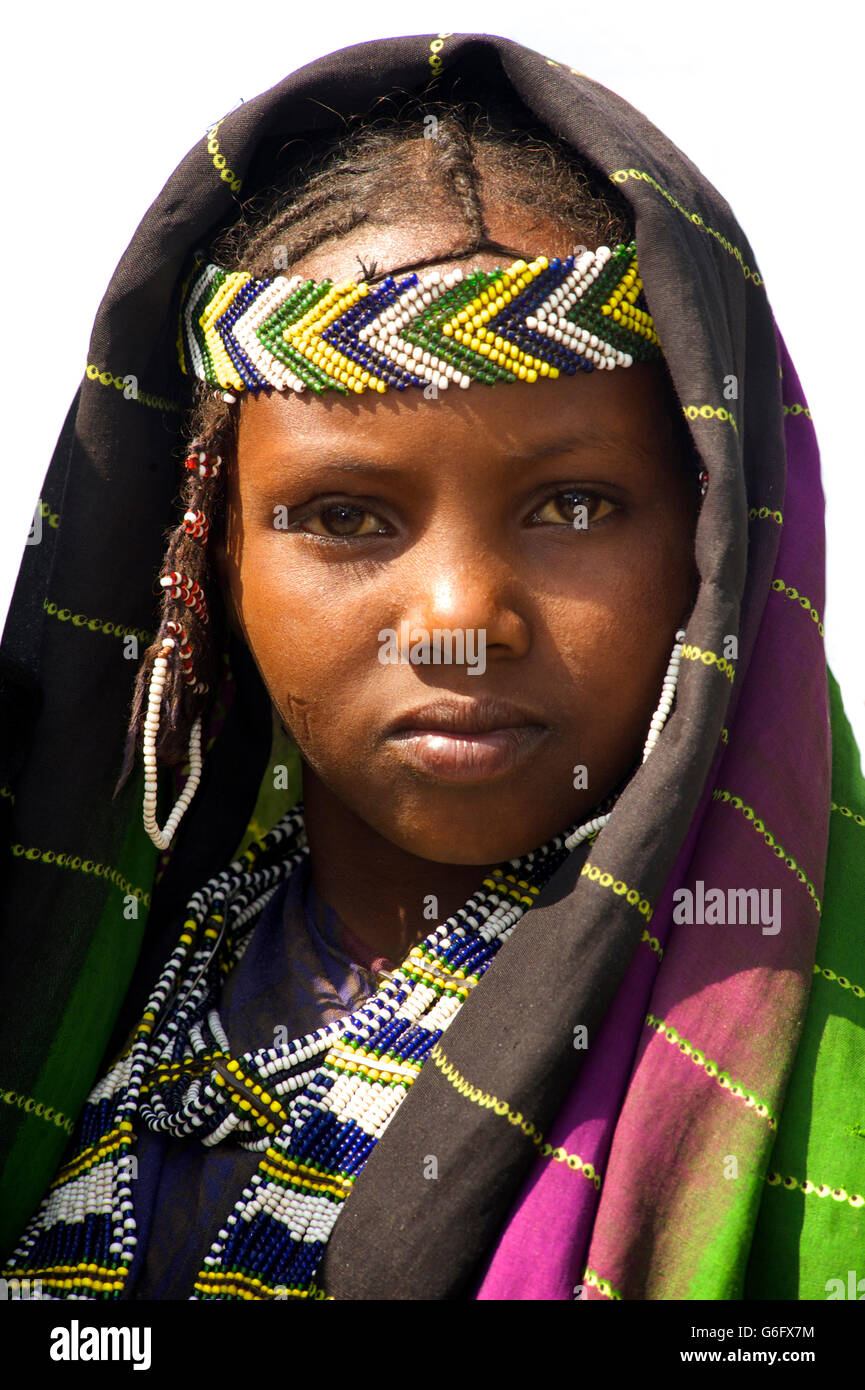 An Afar girl in tribal attire. The nomadic Afar  live in the low-lying deserts of Eastern Ethiopia. Welo Province. - Stock Image