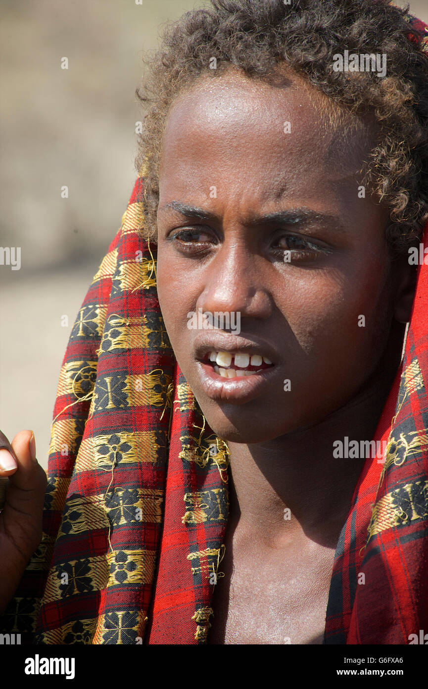 Afar boy with woven fabric on head. The nomadic Afar  live in the low-lying deserts of Eastern Ethiopia. Welo Province, - Stock Image