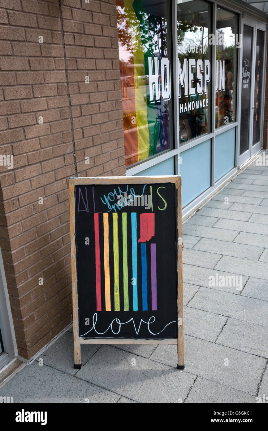 Store sign encouraging love and tolerance, especially for the LGBT community, from downtown Indianapolis. Indiana - Stock Image