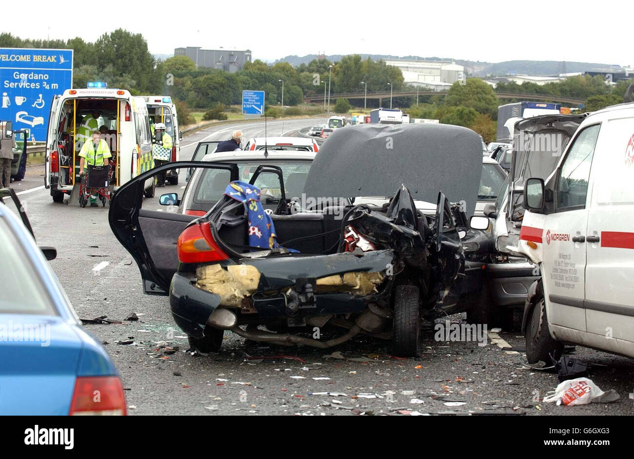 A car stands ruined after a crash involving 12 vehicles on the northbound carriageway of the M5 motorway near Bristol. Up to a dozen people were injured in the accident, which happened between junctions 20 and 19 of the motorway shortly after 1pm. The cause of the crash was not yet known, but a police spokesman said there were reports of a heavy downpour at around the time of the incident. Stock Photo
