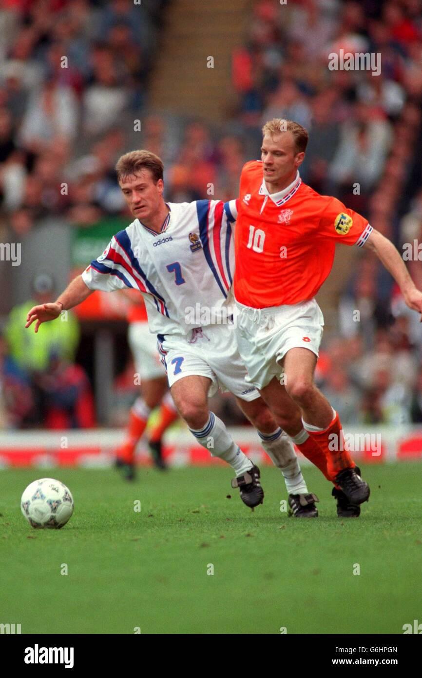 EURO 96 - SOCCER - France v Netherlands (Holland). Didier Deschamps (F) - Dennis Bergkamp (N) Stock Photo