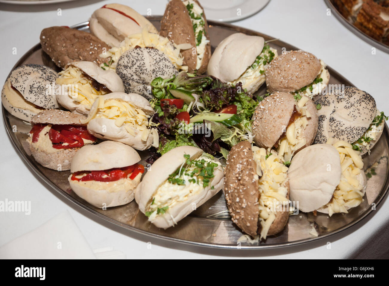 bread rolls with various fillings at a party - Stock Image